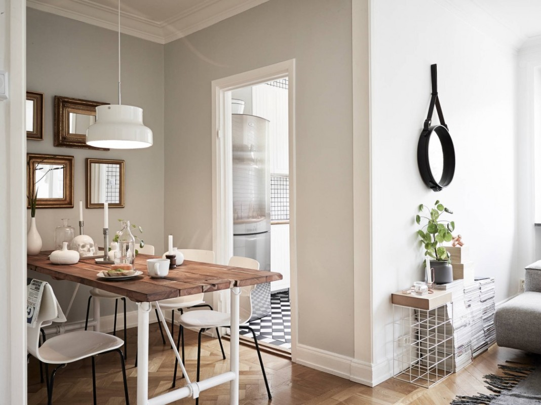 tiny-stylish-apartment-dining-room-in-sweden-decor-with-rectangular-reclaimed-wood-dining-table-using-white-polished-iron-legs-be-equipped-white-acrylic-dining-chairs-which-has-black-polished-steel-le